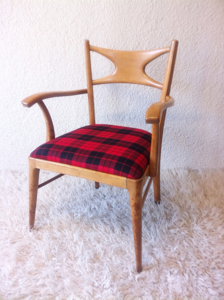 Armchair with wooden frame and upholstered with wool plaid