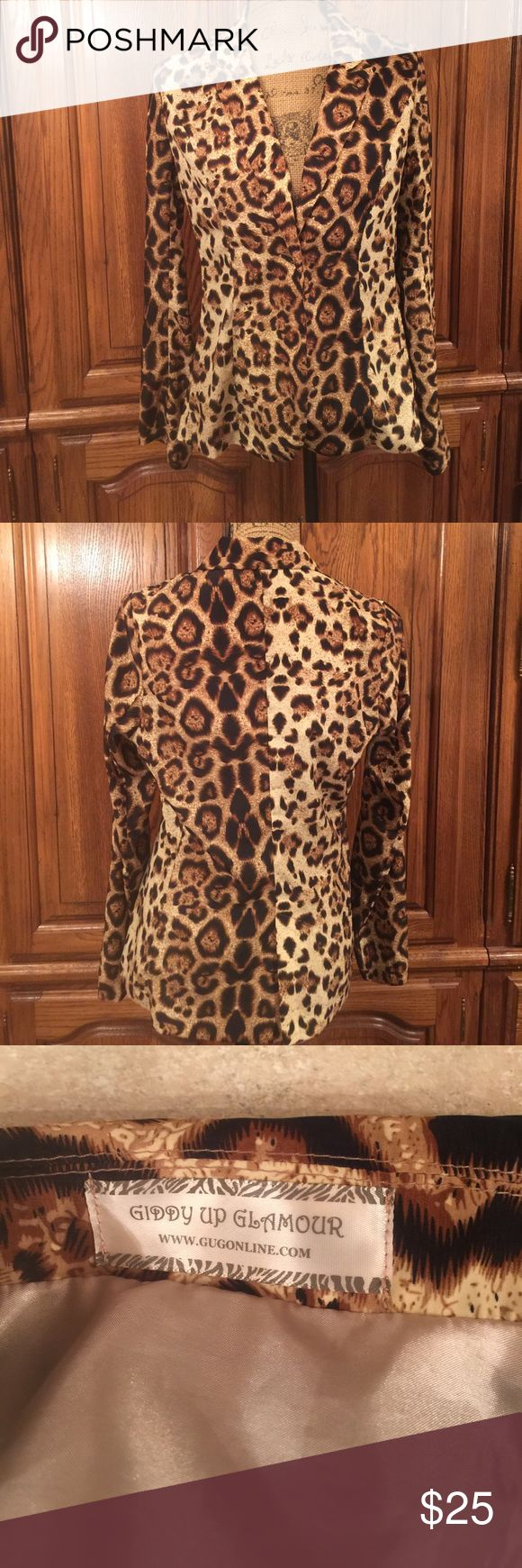 "Giddy up Glamour Animal Print Blazer EUC size large made of 100% polyester. One button closure. No pockets. This is very lightweight. It measures approximately 19"" flat underarm to underarm and the waist measures approximately 16"" flat. The hips measure approximately 18"" flat. It measures approximately 24.5"" long measured from shoulder to hem and the sleeves measure approximately 24"" long. The shoulders measure approximately 15"" flat Giddy Up Glamour Jackets & Coats Blazers"