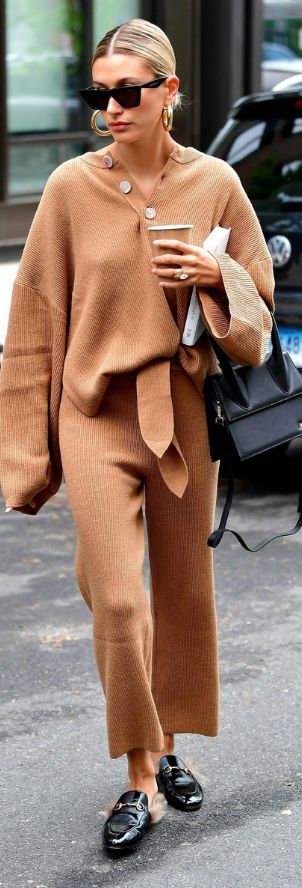 Who made Hailey Baldwin's tan pants, beige sweater, black mule shoes, handbag, and gold jewelry?