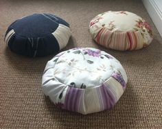 My zafu family, made using instructions from http://www.finecraftguild.com/how-to-zafu-meditation-pillow/