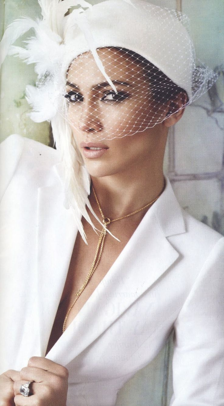 Jennifer Lopez graces the pages of Vanity Fair Sept 2011 Issue looking great in an all white suite and a breath-taking Christine Moore hat with white feathers.
