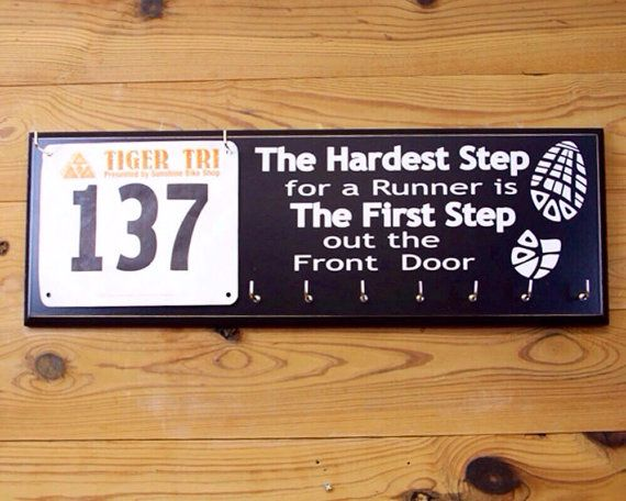 Runner's Race Medal and Race Bib Display with inspirational running quote - The Hardest Step for any runner.