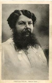 """Clementine Delait who was born in 1865 in a small town in France. She grew her beard on a bet. Married to the owner of a local cafe, she shaved every day because she had a hairy chin since childhood. When the circus visited a nearby city and the cafe customers were talking about the bearded lady they had seen there, Clementine boasted.   """"I could produce a better beard than that."""""""