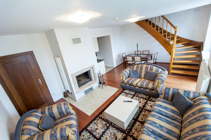 comfy living room with fireplace in Park View Apartment  #wilislovakia#wilitatry