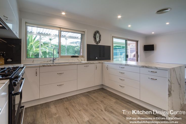 A modern, black and white kitchen that's completely family friendly in every way.  www.thekitchendesigncentre.com.au @thekitchen_designcentre