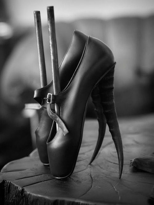 Hussein Chalayan - these shoes are very butronesque as they are dark as most of his characters are (nightmare before Christmas) also the style and design of them are quite weird but pretty to look at.