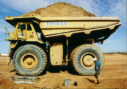 This is a very large dump truck. Not the biggest I've ever seen, but it's pretty big.