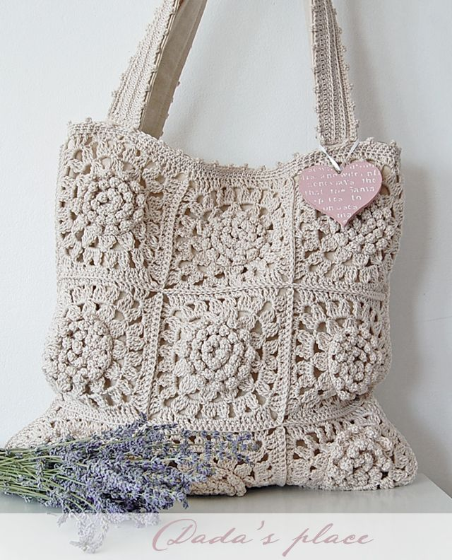 Crochet bag.. I believe there's a pattern for the square here on her blog somewhere.. would work over the tote bags I have that I never used..