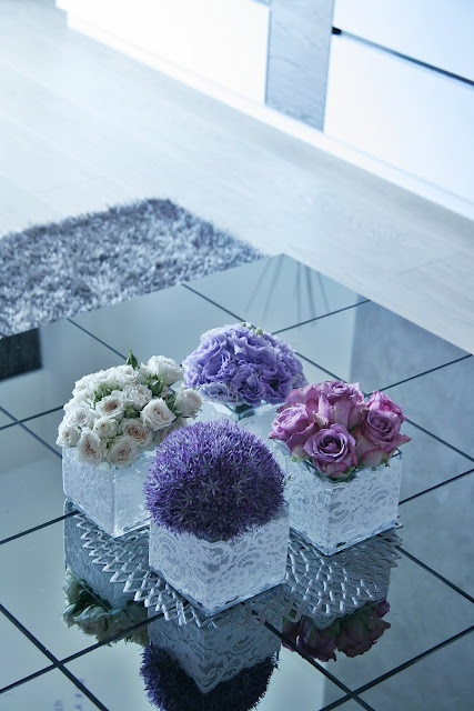 Coffee Table Flowers. Modern and classy.  Using a cluster of one type of flower in each vase creates a unique look.