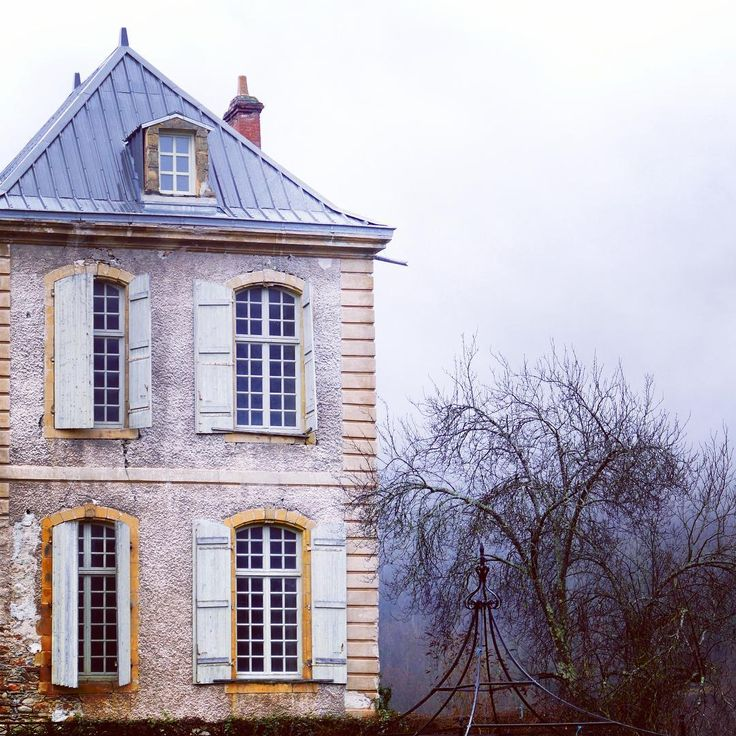 Magnificent architecture and aged to perfection facade of French chateau with shutters and arched windows. South of France Fixer Upper Château Gudanes. #southoffrance #frenchchateau #provence #frenchcountry #renovation