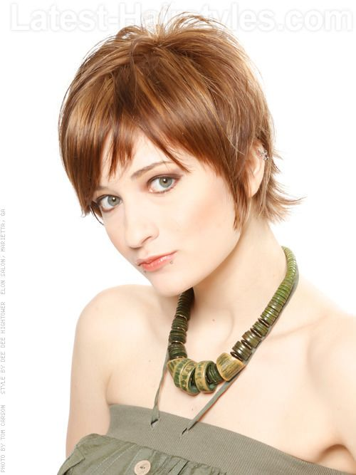 Face Framing Style - This style features a longer fringe and plenty of face framing layers. It's a great short look because it has hair framing your face, but it's short and layered in the back which makes it easy to style and also very fashionable!
