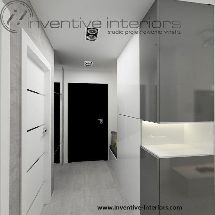 Projekt przedpokoju Inventive Interiors - beton, biel i szarość w przedpokoju