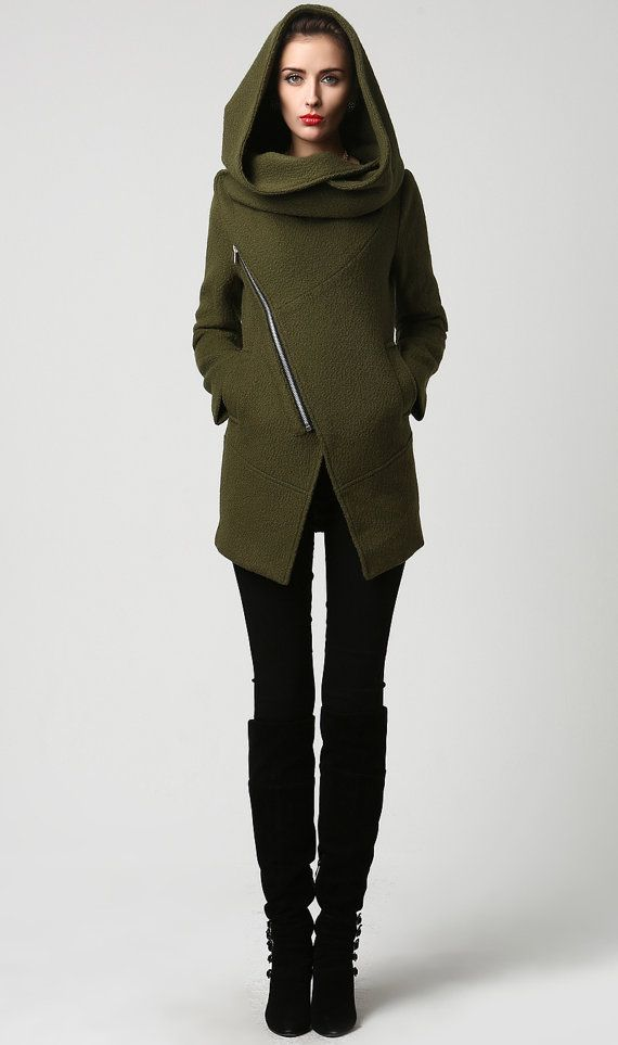 Its nice but I've got a feeling that if you've got a busty bosom, it won't look that great. Short green wool coat with hood and asymmetrical design.