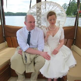 bride and groom on a boat in Bath: Bride