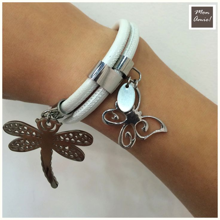 White leather bracelet with metal butterfly and and a dragonfly.