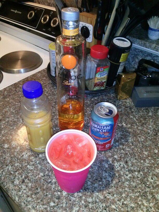 Peach CIROC Orange juice and Hawaiian Punch!! Pretty good. :)