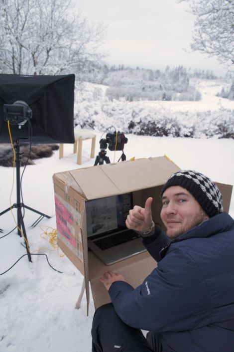 Interior in the snow, Scandinavian winter. Christian is directing the shoot in a cardboard box <3 it