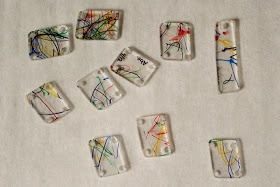 L's teachers did this for mothers' day.  It's great!  Homemade shrinky-dink pendants.