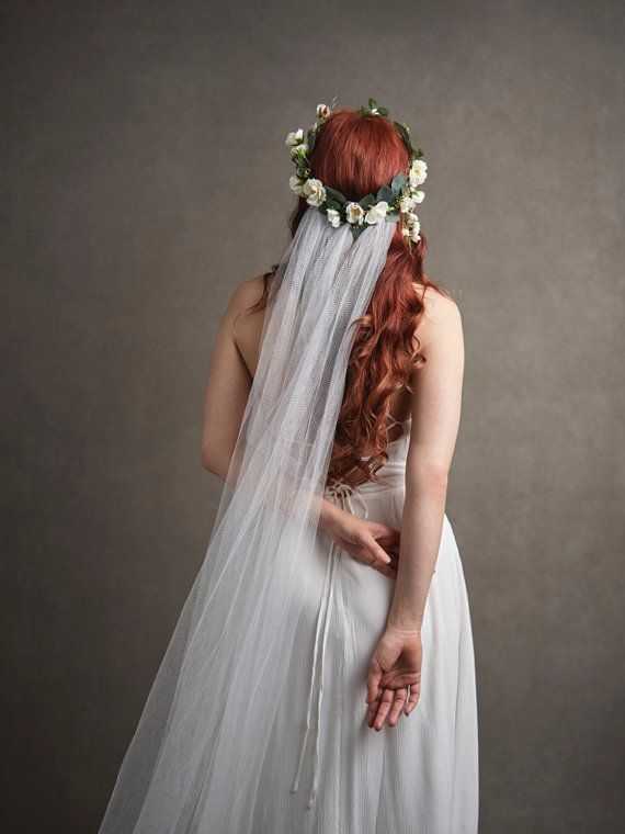 This is Guinevere, a floral crown decorated with woodland roses and a billowy…