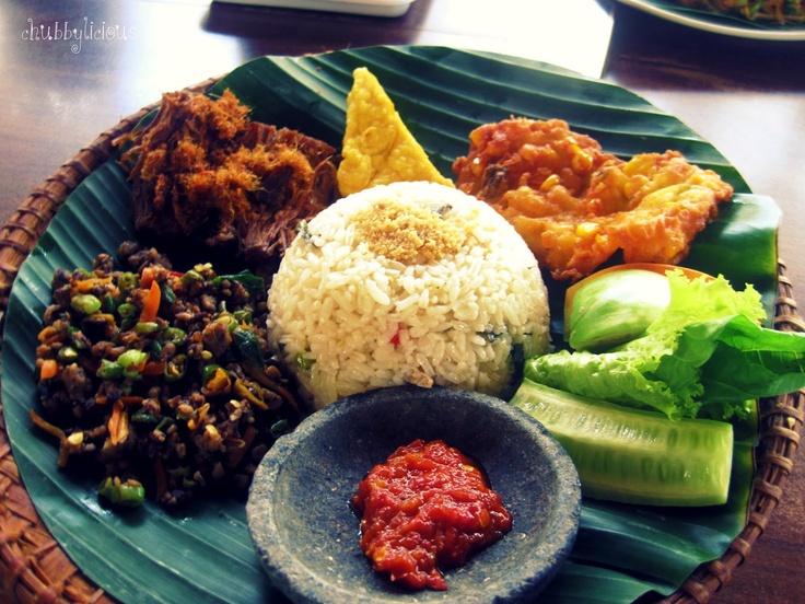 Nasi timbel (rice, sambal terasi, krecek oncom, corn fritters, and empal gepuk)