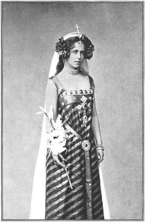 Queen Marie of Romania. Granddaughter of Queen Victoria.  Good old Queen Marie. She's so utterly improbable.