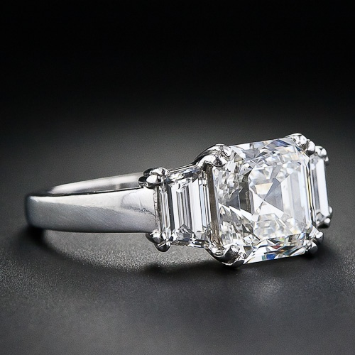 If she's worth a diamond ring...its gonna be a unique one, not something that anyone can walk into Tiffany and get...how about a 3 karat asscher cut diamond set in platinum?