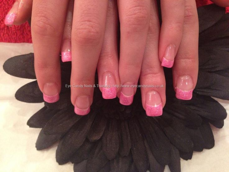 Full set of acrylic nails with pink gel polish on tips