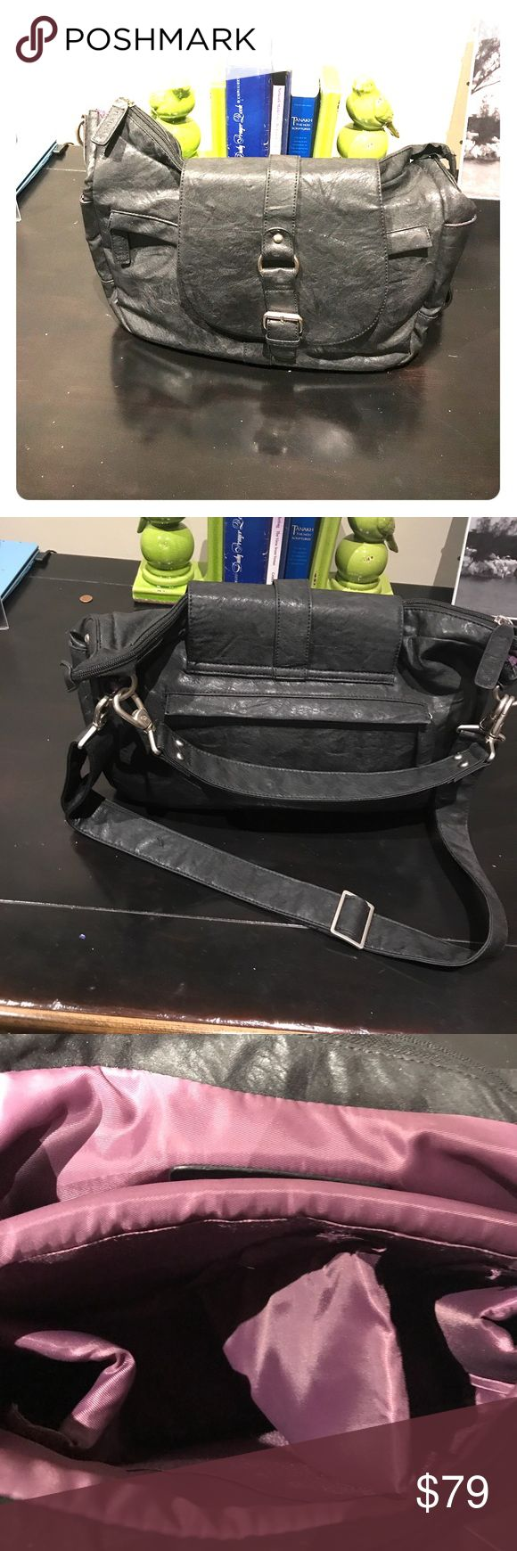 Kelly Moore Photography Bag This bag is great.  It looks like a bag but has plenty of room for DSLR cameras and some lenses to.  Plenty of room for your personal essentials as well. Kelly Moore is known for making stylish photography bags Kelly Moore Bags Shoulder Bags