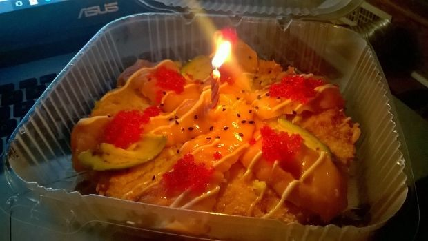 Halifax sushi restaurant makes lonely customer's birthday 'awesome'. | After a Halifax sushi restaurant received an online order from a man who was having a hard month, the staff put together a special birthday delivery — complete with a candle on a sushi pizza.