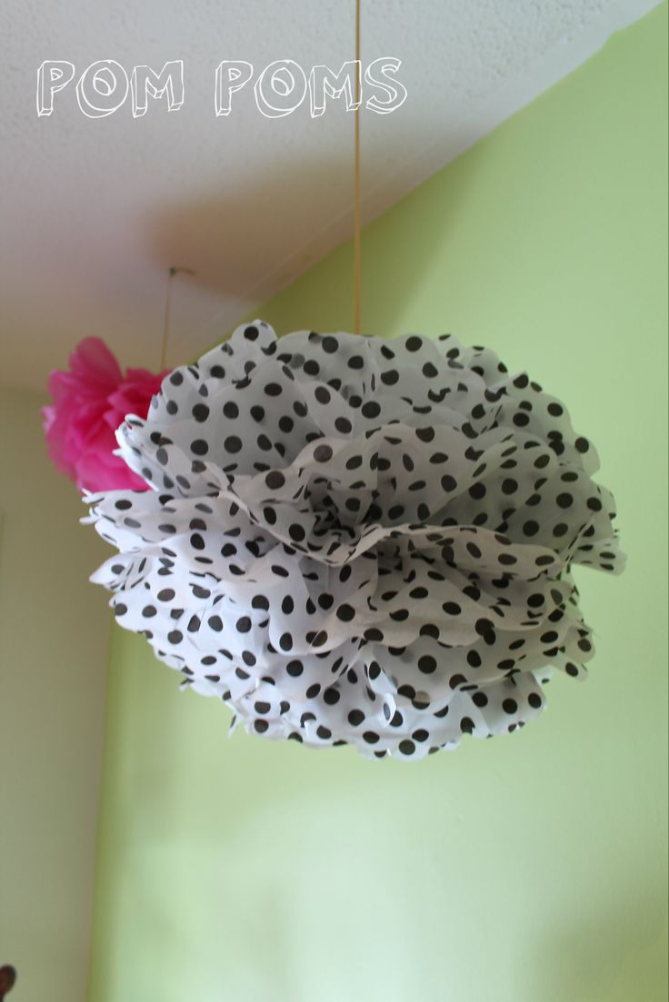 "We had a combination of ""pre-made"" Kate Spade Polka Dot Pom Poms ($18 for a package of 3) from Chapters and DIY dollar store tissue paper ones ($1 a Pom Pom made from 12 pieces of tissue paper). I would recommend purchasing the tissue paper and making them yourself as the time consuming part is fluffing the Pom Poms which you have to do with the pre- made ones anyway. Although, I thought that the polka dot ones were really cute!"