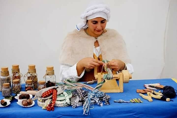 Historical tablet weaving during a medieval fair. You can buy a complete tablet weaving loom set in my shop.