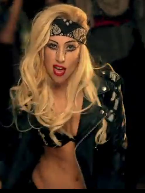 Gaga video still- Judah - generic biker chick with polish - bandana leather jacket hair volume
