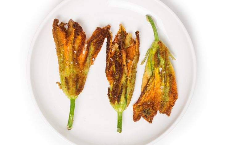 Ricotta-Stuffed Squash Blossoms With stretchy mozzarella inside and a coating of crunchy breadcrumbs, these get the creamy-crispy ratio just... #BonAppetit