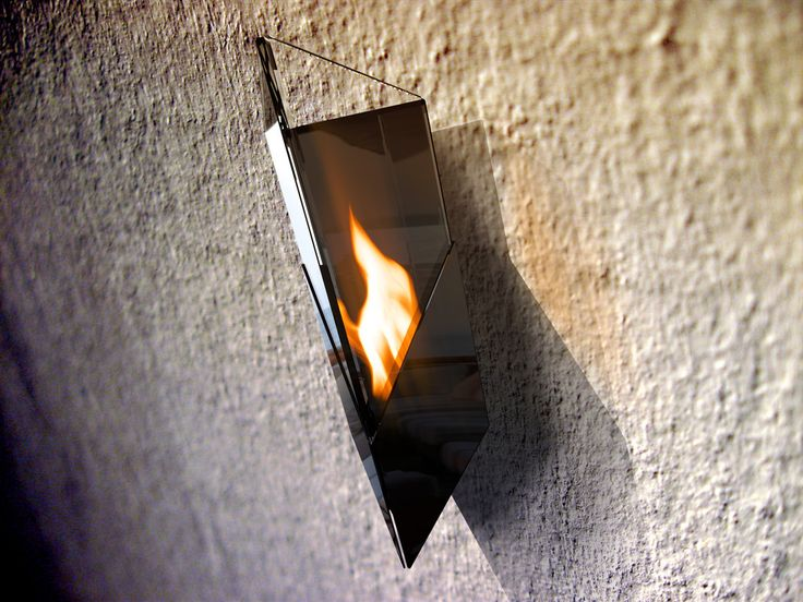 PURE  (Black/Silver) Wall-Mounted Fireburner  Pure (Black/Silver) Wall-Mounted Fireburner is a temptress made of tempered glass panes and solid steel. A structure of beauty and graceful elegance, Pure is purely perfect in its incarnation and form.