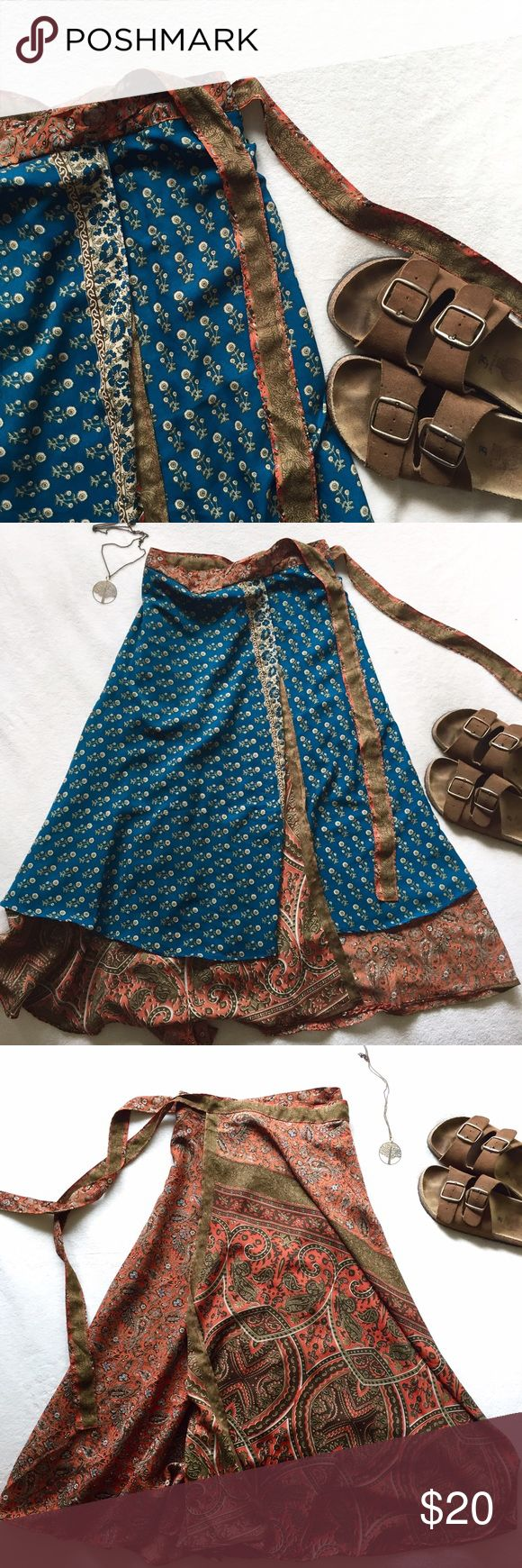 "Reversible Boho Hippie Wrap Skirt So perfect for festival season! This is a wrap-style skirt that feels oh-so-wonderful swishing when you walk  silly material, no tag so I'm not 100% certain of fabric content  reversible, with gorgeous designs on both sides. I'm 5'4"" and this is a long midi/maxi length for me, and you can adjust the length by wearing it high waisted or at the hips. Waist is adjustable, but best for S/M. ⭐️skirt only⭐️ Skirts Maxi"