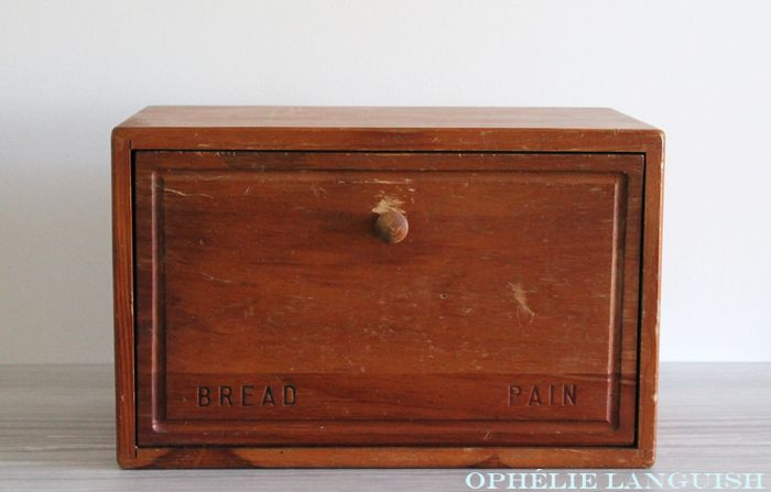 Solid wood, quality made bread box. Displays the word bread in both French and English. Secure magnetic closure. Could easily add a shelf inside to sit upon the built-in rails to divide the box. This rustic piece would look excellent in any country, cottage, or French kitchen.