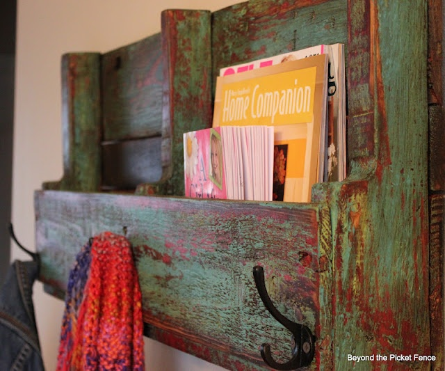 great finish on this pallet shelf - slash - coat hanger! Great idea