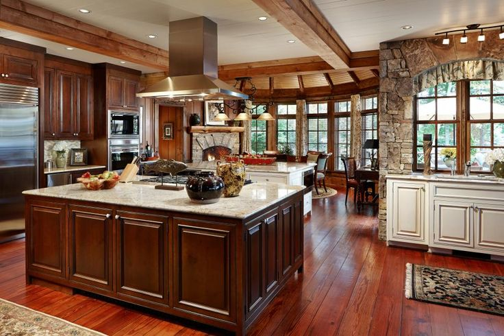 The professionally-equipped kitchen is the ultimate centerpiece for entertaining with three islands, four dining areas and a cozy fireplace.