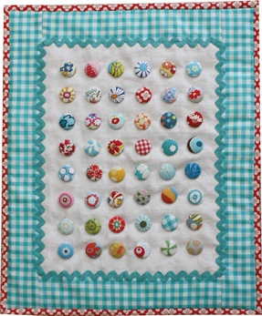 Fabric covered button small quilt.  Could be done with yo-yo's too.