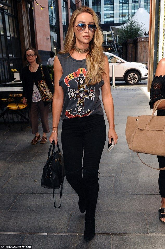 Rock on: Lauren Pope decided to spice up her wardrobe by channelling her inner rock chick while in Manchester on Monday