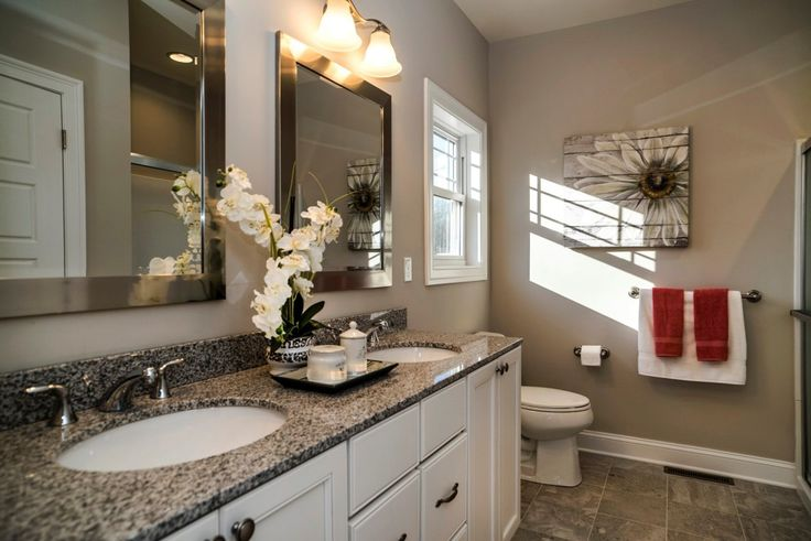 Beautiful granite counter accents the double sink vanities.