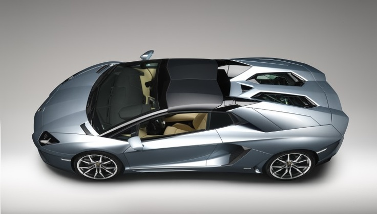 Aventador LP700 Roadster (2012) features a two-piece removable carbon fiber roof employing...