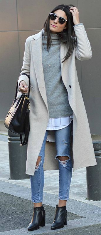 Federica L. + casual style here + pair of heavily distressed denim jeans + oversized printed blouse + gorgeous cashmere sweater Outfit: Zara.