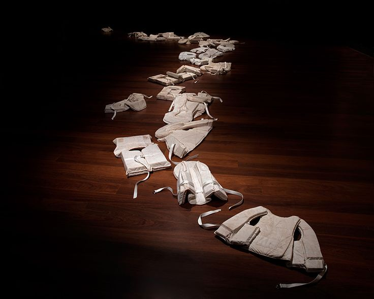 alex seton memorializes asylum seekers with 28 marble life jackets