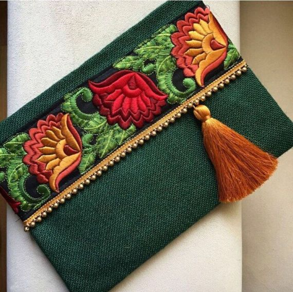 Ethnic clutch, boho bag, bohemian clutch, gift for her, clutch purse  A fashion statement that everyone will swoon over! This ethnic clutch will bring elegance to your style. It will be chic with jeans or dresses and you may use this clutch bag both day and night. This fashion clutch bag is perfectly handmade with high quality green jute fabric. Designed with a silk bohemian embroidery and a tassel. Clutch has a silk satin interfacing and a padding inside to stand upright. Closes with a…