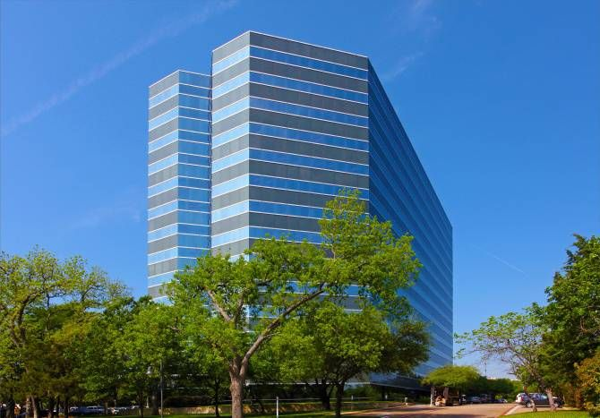The Miami-based commercial property firm purchased the 14-story Rambler Park office tower in North Dallas.