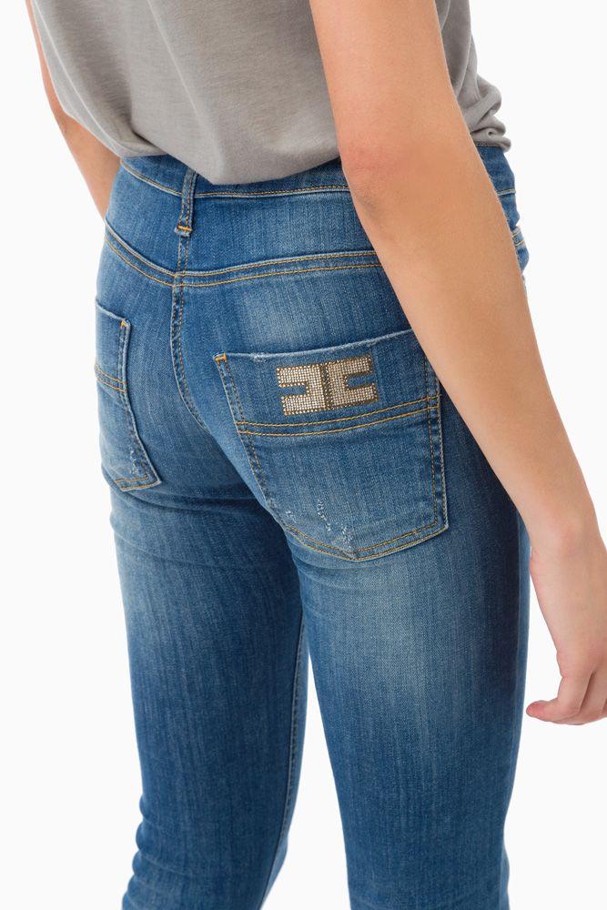 Jeans con logo micro-borchie