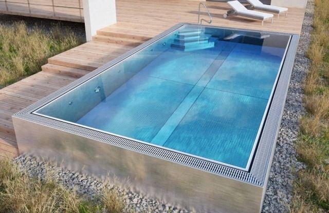 piscine enterrée en forme rectangulaire et petits galets                                                                                                                                                                                 Plus