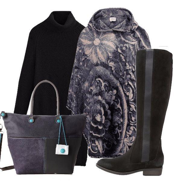 Questo look è perfetto per affrontare i primi freddi con stile. La mantella fantasia è abbinata ad un vestitino in maglia nero a degli stivali bassi in camoscio e ad una borsa da portare sia a mano che a spalla.