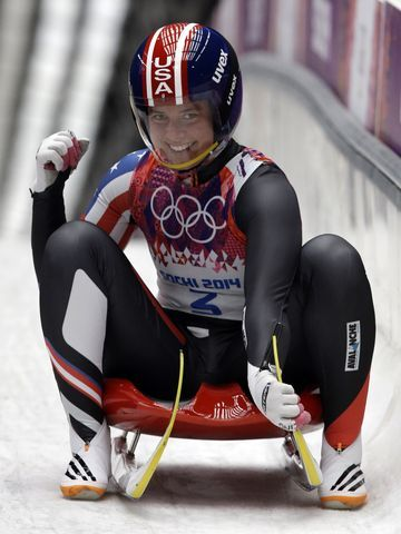 Kate Hansen of the United States brakes in the finish areas after her second run during the women's singles luge competition at the 2014 Winter Olympics - USA Today